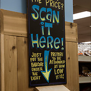 """Sign in Trader Joe's """" Can't Find the Price? Scan It Here! """" """"Just put the barcode under the light"""""""