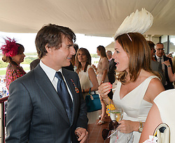 TOM CRUISE and NATALIE PINKHAM at the 2014 Glorious Goodwood Racing Festival at Goodwood racecourse, West Sussex on 31st July 2014.
