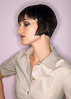 Woman with bobbed hair profile in studio