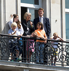 © Licensed to London News Pictures. 27/05/2015. London, UK. Labour MP TRISTRAM HUNT and a group of unknown people watch from Portcullis House as Queen Elizabeth II travels in a horse drawn carriage from Buckingham Palace infant of Elizabeth Clock Tower and the houses of parliament to attend State Opening of Parliament in London on May 27, 2015. Photo credit: Ben Cawthra/LNP