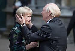 © Licensed to London News Pictures. 20/06/2016. London, UK. Lord and Lady Kinnock are overcome with emotion as they leave Margaret's Church, Westminster Abbey after attending a Service of Prayer and Remembrance to commemorate Jo Cox MP, who was killed in her constituency on June 16, 2016. Photo credit: Peter Macdiarmid/LNP