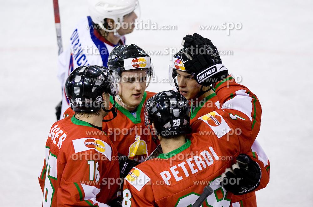 Players of Hungary celebrate at IIHF Ice-hockey World Championships Division I Group B match between National teams of Hungary and Croatia, on April 20, 2010, in Tivoli hall, Ljubljana, Slovenia.  (Photo by Vid Ponikvar / Sportida)