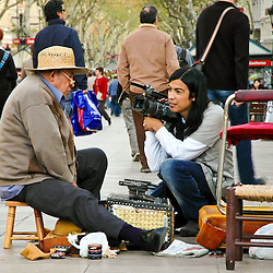 It is not uncommon to see students with cameras trying to get a close up look at the sole of La Rambla.