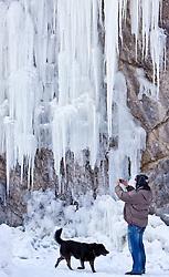 THEMENBILD - Sibirische Kaelte in Europa, derzeit sorgt das Sibirische Hoch Cooper in Europa fuer Temperaturen jenseits des Gefrierpunktes. In Oesterreich werden Temperaturen bis zu minus 20 Grad erwartet und es gibt schon die ersten Todesfaelle durch die grosse Kaelte in ganz Europa, im Bild ein Spaziergänger fotografiert in der Nähe von Kaprun (Salzburg) eine Feldwand auf der sich Eiszapfen gebildet haben // Siberian cold weather in Europe, currently the Siberian high Cooper makes temperatures beyond zero in Europe. In Austria, temperatures down to minus 20 degrees expected and there is already the first deaths of the great cold weather throughout Europe. A walker photographed near Kaprun (Salzburg), a cliff on there have formed icicles, EXPA Pictures © 2012, PhotoCredit: EXPA/ Juergen Feichter