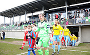 The teams come out to kick off their 5th round match during the Women's FA Cup match between Charlton Athletic WFC and Crystal Palace LFC at Sporting Club Thamesmead, Thamesmead, United Kingdom on 8 March 2015. Photo by Michael Hulf.