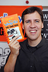 © Licensed to London News Pictures. 12/12/2014 <br /> Author of the best-selling 'Wimpy Kid' series Jeff Kinney was at Waterstone's, Bluewater in Kent tonight (12.12.2014) signing copies of his latest Wimpy Kid book,  The Long Haul.  As well as being an  international bestselling author Jeff is also an online developer and designer.Jeff has been named one of  Time magazine's most influential people in the world. His original Dairy of a Wimpy Kid was voted best childrens book of the last ten years by UK readers. Jeff lives with his family in Massachusetts,USA.<br /> <br /> (Byline:Grant Falvey/LNP)