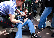 Russian police stop a gay activist (right) from being beaten by a nationalist (left). Authorities, neo-Nazis and Orthodox Christians forcefully prevented gay and lesbian rights activists from rallying in Moscow..Homosexuality was decriminalized in Russia in 1993. Moscow has repeatedly banned gay parades, including this one. .