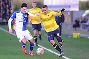 Oxford United Midfielder Kemar Roofe battles Blackburn Rovers Midfielder Ben Marshall  during the The FA Cup Fourth Round match between Oxford United and Blackburn Rovers at the Kassam Stadium, Oxford, England on 30 January 2016. Photo by Dennis Goodwin.