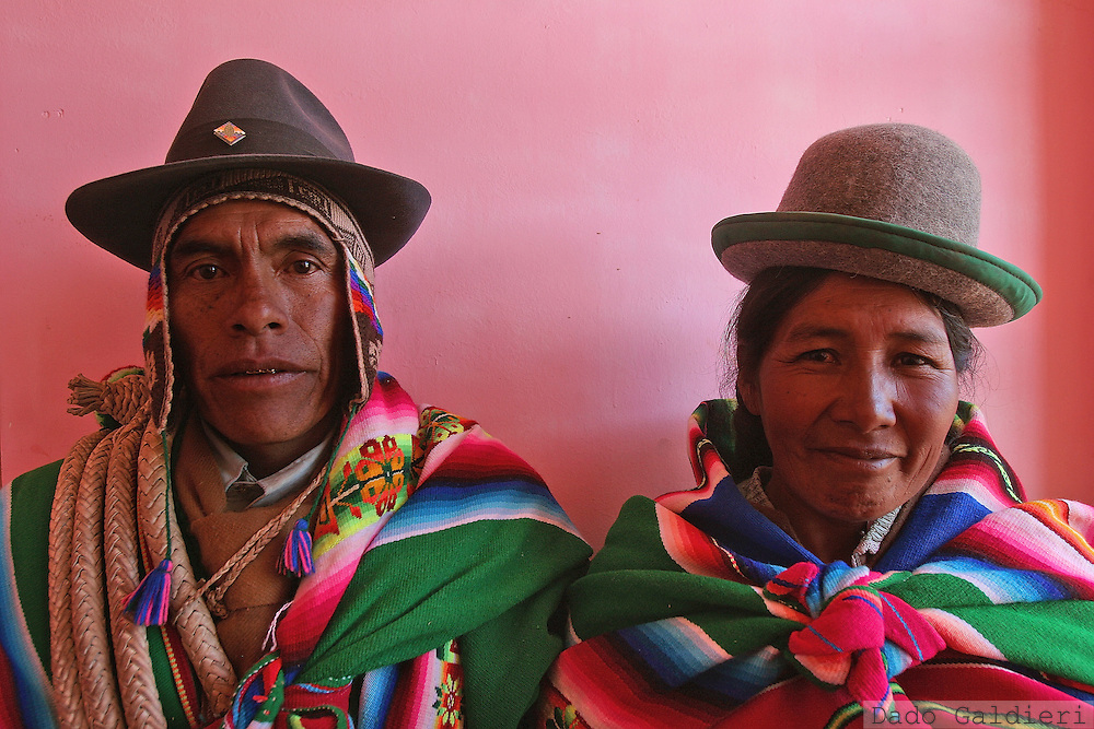 "An Aymara couple, Sabino Soto Mollo and Genara Ninachoque Choque, pose for a portrait prior attending a meeting of the 12 municipalities that form Jacha Carangas, a traditional region of Aymara ethnic group known for their green ponchos in the city of Curahuara de Carangas, some 200 km southeast of La Paz, Bolivia on Tuesday, June 20, 2006.(Dado Galdieri) We ant to enter the Congress as we are, dressing sombreros, ponchos and abarquitas""."