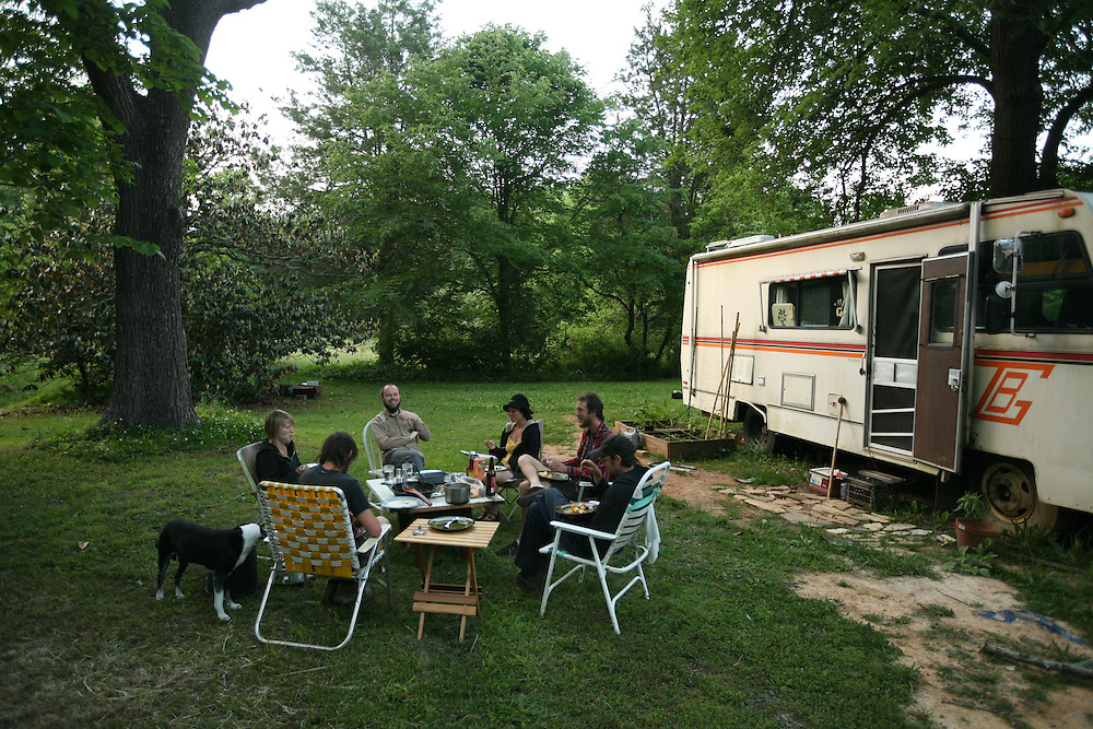 Pittsboro, NC - May 13: The group eats dinner at  the farm at Circle Acres. (Photo by Logan Mock-Bunting)