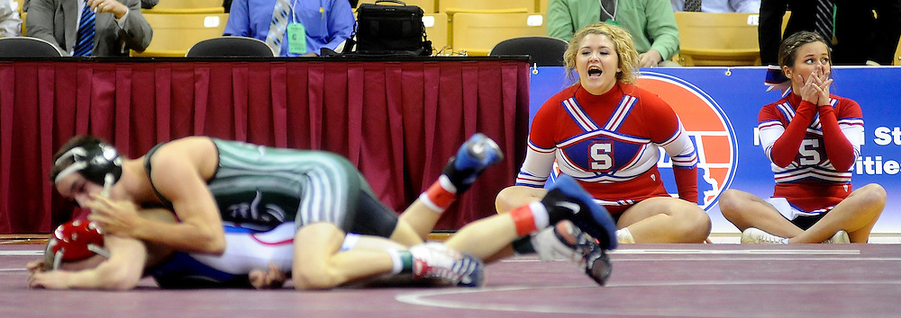 Seneca cheerleaders gasp as Sainte Genevieve's Tyler Jones storms back to claim two points in the final second of regulation to force overtime with Seneca's Will Roark in the Class 2 113-pound championship match during the 2012 MSHSAA Wrestling Championships at Mizzou Arena in Columbia, Mo. Jones would go on to claim the title with an overtime decision.