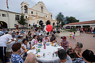 Participants enjoy the free food during National Night Out in San Gabriel, California, on Tuesday, Aug. 1, 2017. National Night Out is a community-police awareness-raising event in the United States and Canada, held the first Tuesday of August. Texas and Florida have the option to use the alternate date of the first Tuesday in October to avoid hot weather.(Photo by Ringo Chiu)<br /> <br /> Usage Notes: This content is intended for editorial use only. For other uses, additional clearances may be required.
