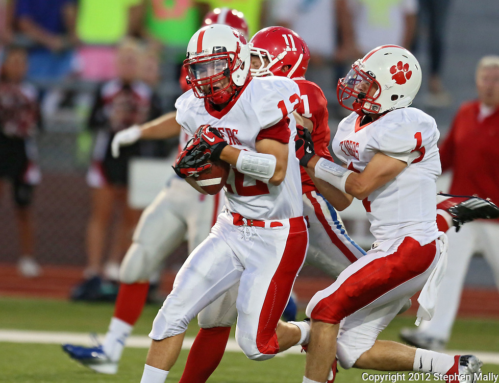 Cedar Falls' Brayden Longnecker (12) pulls in an interception during the game between Cedar Falls and Cedar Rapids Washington at Kingston Stadium in Cedar Rapids on Friday, September 7, 2012.