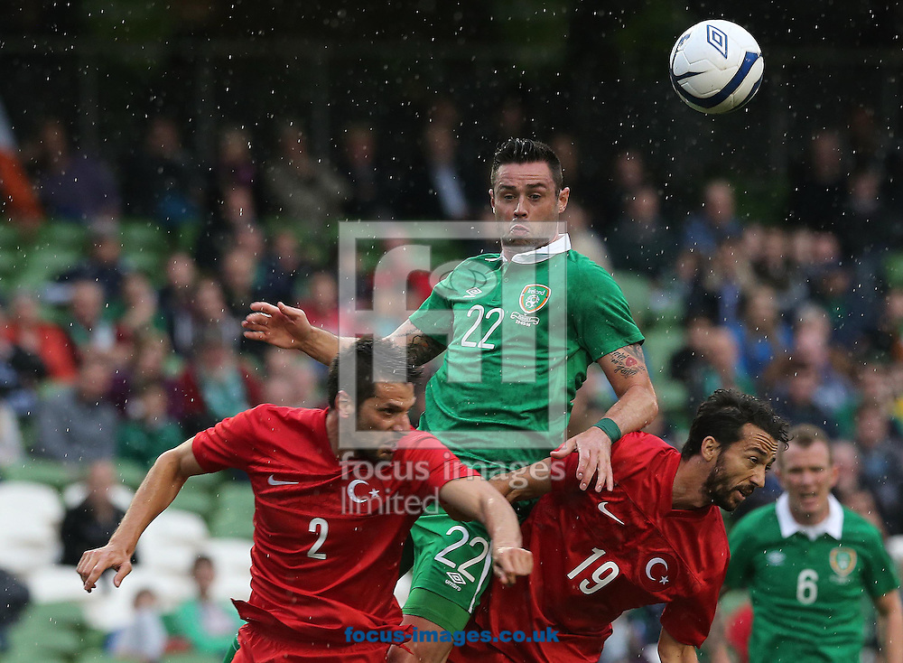 Damien Delaney of Republic of Ireland challenged by Hakan Kadir Balta and Bilal Kisa of Turkey during the International Friendly match at the Aviva Stadium, Dublin<br /> Picture by Lorraine O'Sullivan/Focus Images Ltd +353 872341584<br /> 25/05/2014