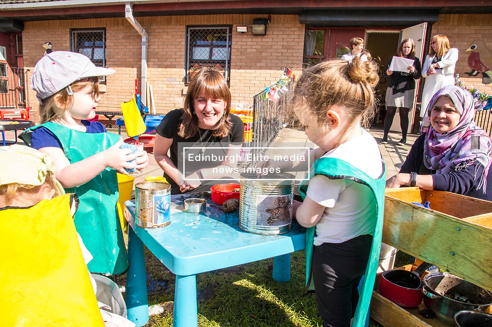 Pictured: Maree Todd took the opportunity to meet some of the children including Skye (3 green tabard), Zuzanna (3 Dora hat); Olivia (2 Blue t-shirt) and Harriet (3 green hat).<br /> <br /> The Minister for Childcare and Early Years, Maree Todd visited North Edinburgh Childcare and Training centre today and welcomed the childcare deposit pilot. Ms Todd met staff and children at the centre to discuss the pilot.<br /> <br /> Ger Harley | Edinburgh Elite Media