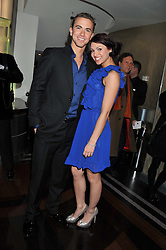EMILY HAWGOOD and RICHARD FLEESHMAN at the What's On Stage Awards 2012 held at the Prince of wales Theatre, London on 19th February 2012.