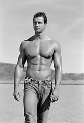 shirtless hunk walking in the desert