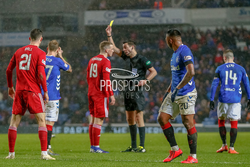The Referee books Lewis Ferguson of Aberdeen FC during the William Hill Scottish Cup quarter final replay match between Rangers and Aberdeen at Ibrox, Glasgow, Scotland on 12 March 2019.