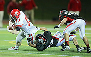 Iowa City High's Jake Leohr (18) is pulled down by Linn-Mar's Luke Meyer (52) on a run during during the game between the Iowa City High Little Hawks and the Linn-Mar Lions at Linn-Mar Stadium in Marion on Friday October 12, 2012.