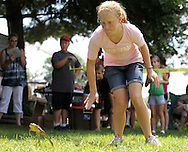Katie Neumeyer, 13, of Cedar Rapids chases after her frog in the Frog Jumping competition at the Walker Pickle Days in Walker on Saturday, July 30, 2011. Activities included a 5K run/walk, kid's fun run, horseshoe tournament, craft show, backyard games tournament, parade, and fireworks.