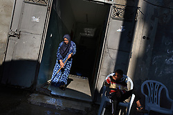 A Palestinian woman is seen in front of her home, which was damaged by Israeli artillery fire, Beit Hanoun, Gaza Strip, Palestinian Territories, Nov. 17, 2006. According to Human Rights Watch, since September 2005, Israel has fired about 15,000 rounds at Gaza while Palestinian militants have fired around 1,700 back.
