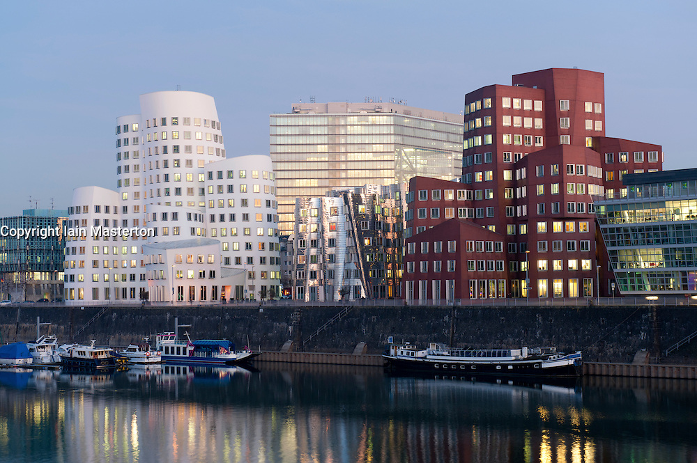 View of Neuer Zollhof office buildings designed by Frank Gehry in modern property development at Media Harbour or Medienhafen in Dusseldorf Germany