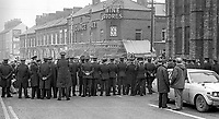 Police, RUC, halt two of the 20th October 1976 funerals of three members of the Provisional  IRA who died on 16th October 1976 when the bomb they were planting at Belfast Gasworks exploded prematurely, until Irish Tricolours are removed from the coffins. The three who died were Paul Marlowe, 32 years, Francis Fitzsimmons, 29 years, and Joseph Surgeoner, 24 years.  197610200431b<br />