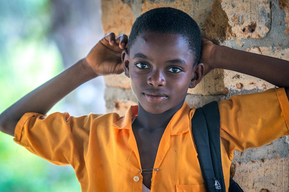 A boy poses in his school uniform for the camera in Ganta, Liberia