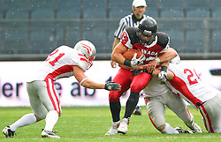 11.07.2011, UPC Arena, Graz, AUT, American Football WM 2011, Group B, Canada (CAN) vs Austria (AUT), im Bild Matt Walters (Canada, #33, RB) gets stopped by Markus Krause  (Austria, #21, DB), Florian Hueter (Austria, #58, LB) and Manuel Schneeweiss (Austria, #24, DB)  // during the American Football World Championship 2011 Group B game, Canada vs Austria, at UPC Arena, Graz, 2011-07-11, EXPA Pictures © 2011, PhotoCredit: EXPA/ T. Haumer