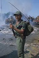 El Salvador. The sea side road after the attack by the guerilla, burnt bus and trucks , destrucion      / la route du littoral attaquee par les guerilleros, bus et camions incendies, arbres abattus, lignes electriques coupees    Salvador  / SALV34232 1