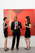 Young executives having a conversation in front of painting in museum
