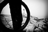 Peggy's Point Lighthouse as seen through an anchor, Peggy's Cove, Halifax, Nova Scotia.
