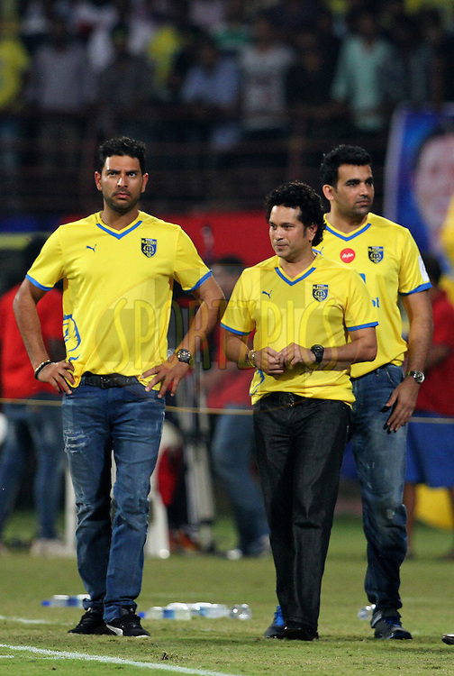 Sachin Tendulkar, former Indian cricket player and co-owner Kerala Blasters FC with Indian cricket players Yuvraj Singh and Zaheer Khan during the 1st Semi Final match of the Hero Indian Super League between Kerala Blasters FC and Chennaiyin FC held at the Jawaharlal Nehru Stadium, Kochi, India on the 13th December 2014.<br /> <br /> Photo by:  Vipin Pawar/ ISL/ SPORTZPICS