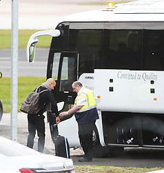 Pep Guardiola and other members of the Manchester City team are seen at Manchester Airport as they travel for their Champions League fixture.