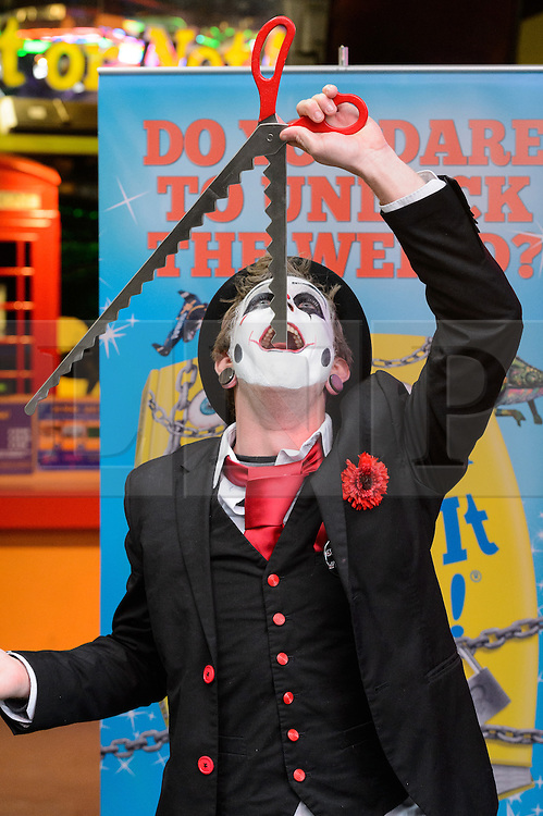 © Licensed to London News Pictures. 25/10/2016. Tyler Sutter performs sword swallowing stunt at the launch of Ripley's Believe It or Not! 2017 Annual. London, UK. Photo credit: Ray Tang/LNP