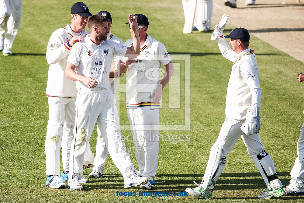 Jamie Harrison of Durham County Cricket Club (2nd left ) celebrates a wicket with his teammates during day 4 of the LV County Championship Div One match at the County Ground, Northampton<br /> Picture by Andy Kearns/Focus Images Ltd 0781 864 4264<br /> 16/04/2014