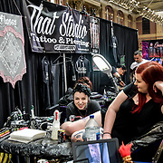 That Studio,Tattoo & Piercing, tattoo a client at The Great British Tattoo Show, on 26 May 2019, London, UK.