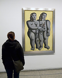 woman looking at painting Two Sisters by Fernard Leger at  the Neue Nationalgalerie or New National Gallery in Kulturforum in Berlin Germany