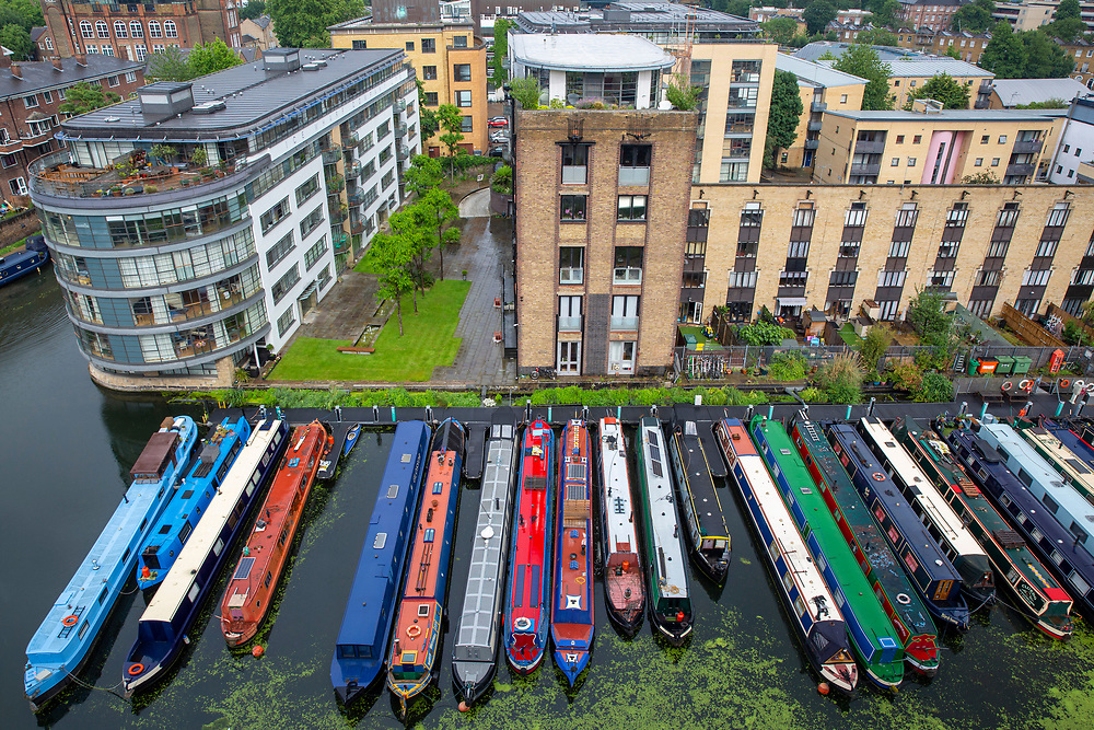 A line of narrow boats moored in the Battlebridge Basin on Regents Canal. Kings Cross, London, United Kingdom. (photo by Andrew Aitchison / In pictures via Getty Images)