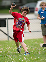 "Jericho Mason of Woodland Heights throws a 26' 11"" shot put during the 5th grade track meet with Elm Street, Pleasant Street and Woodland Heights Elementary School students Wednesday morning at Opechee Park.  (Karen Bobotas/for the Laconia Daily Sun)"