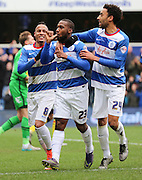 Queens Park Rangers midfielder, (David Hoilett) Junior Hoilett (23) celebrating scoring penalty with Queens Park Rangers midfielder, Tjaronn Chery (8) and Queens Park Rangers defender, James Perch (24) during the Sky Bet Championship match between Queens Park Rangers and Birmingham City at the Loftus Road Stadium, London, England on 27 February 2016. Photo by Matthew Redman.