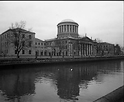 Views of Old Dublin 14/02/1976.02.14.1976.14th February 1976.Picture of Dublin's Four Courts Building. Located beside the River Liffey, building work began on the Four Courts in 1776 and was completed in 1802. The Four Court is the physical centre of legal life in Ireland. Sittings of the Supreme, High, Circuit and District Courts occur there. The dome of the Four Courts is a prominent feature of Dublin's skyline.