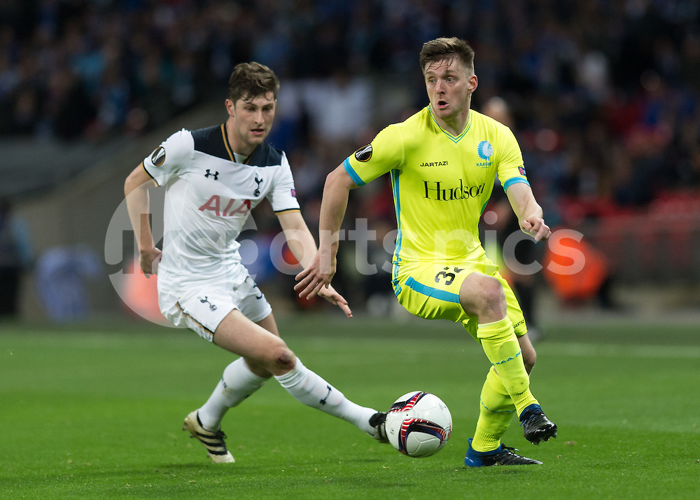Thomas Foket of KAA Gent gets away from Ben Davies of Tottenham Hotspur during the UEFA Europa League  Round of 32 Game 2 match between Tottenham Hotspur and Gent at Wembley Stadium, London, England on 23 February 2017. Photo by Vince  Mignott.
