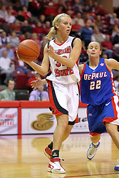 25 November 2007: Missy Mitidiero reaches around Maggie Krick in an attempt to dislodge the ball. The DePaul Blue Demons defeated the Illinois State Redbirds 80-75 on Doug Collins Court at Redbird Arena in Normal Illinois