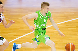 Marcis Vitols  of Latvia vs Luka Rupnik of Slovenia during basketball match between National teams of Latvia and Slovenia in Qualifying Round of U20 Men European Championship Slovenia 2012, on July 16, 2012 in Domzale, Slovenia. (Photo by Vid Ponikvar / Sportida.com)