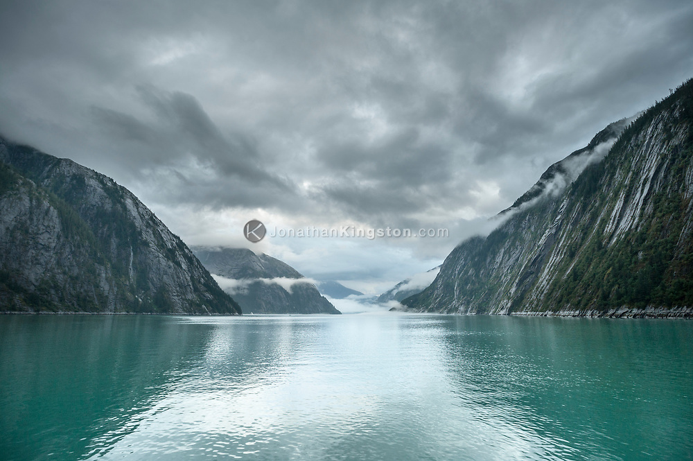 Dramatic clouds over the remarkable glacier carved landscape of Tracy Arm fjord, Alaska.