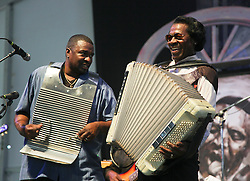 03 May 2015. New Orleans, Louisiana.<br /> The New Orleans Jazz and Heritage Festival. <br /> Buckwheat Zydeco (rt) and his son Sir Reginald Dural play the Blues tent.<br /> Photo; Charlie Varley/varleypix.com