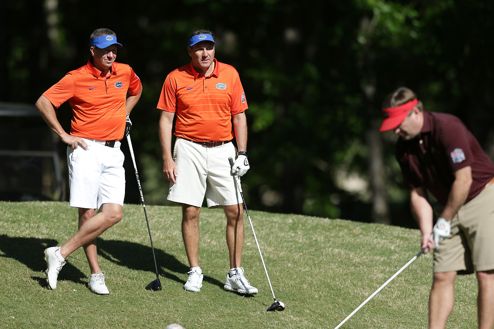 Dan Mullen and Judd Davis watch as Kirby Smart tees off during the Chick-fil-A Peach Bowl Challenge at the Oconee Golf Course at Reynolds Plantation, Sunday, May 1, 2018, in Greensboro, Georgia. (Marvin Gentry via Abell Images for Chick-fil-A Peach Bowl Challenge)