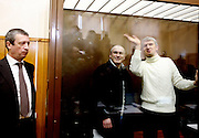 Former Yukos oil giant CEO Mikhail Khodorkovsky and his co-defendant Platon Lebedev, right, smile to the press at a court room in Moscow, Russia, Tuesday, March 31, 2009. The trial begins Tuesday for former oil tycoon Mikhail Khodorkovsky and business partner Platon Lebedev..Khodorkovsky's supporters claim this trial is just a new phase of a reprisal campaign driven by political calculations, commercial interests and personal motives. A new conviction and sentence would send a signal that nothing has changed despite President Medvedev's words, they say, while an acquittal would mark a break with the Putin era.