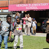Studetns make their way to their buses as school dismisses at Verona Elementary School Tuesday. The oldest building of the complex is being considered to be torn down and rebuilt with a new facility.